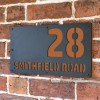 "Orange Brown ""Smithfield"" House Sign in Situ on the Wall"