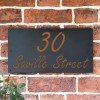 """Orange Brown """"Saville"""" House Sign in Situ on the Wall"""