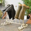 Wrought iron boot rack finished in antique cream