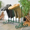 Green wrought iron welly rack