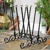 Black wrought iron welly boot rack ornate design