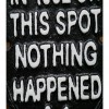 Humorous Emblem Shaped Sign in Black Iron Close-Up