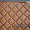 Close-up of the Cushioned Tan Buffalo Leather on the Back of the Seat