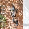 Lantern on royal bracket mounted on brick wall