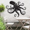 Octopus Wall Art in the Garden Above a Wooden Table & Chair Set