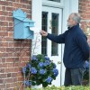 post in parcel box on wall finished in light blue