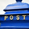 Close up of gold lettering on 'POST'