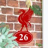 Liver Bird Iron House Number Sign in Situ on a Brick Wall