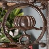 "Close-up of the ""Lotus Flower"" Design on the Iron Shelf Bracket"