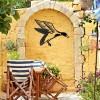 """Mallard"" Duck Wall Art on a Yellow Wall in the Garden"
