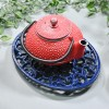 Blue Cast Iron Oval Trivet in Use with Teapot