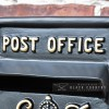 Close-up of the Embossed Post Office Text on the Post Box