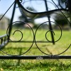 Ornate scroll decorative ironwork on swing bench