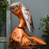 Owl Perched on a Polished Wooden Trunk