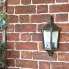 """Penley"" Flush Wall Light in Situ on a Garden Wall"