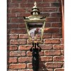 View of the Front of the Polished Brass Harrogate Wall Lantern on Bracket  on a Brick Wall