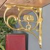 Polished Brass Lotus Flower Shelf Bracket in Situ