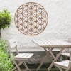 "Geometry ""Flower of Life"" Steel Wall Art in Situ Outside Above a Wooden Table Set"