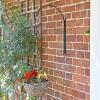 """""""Shepherds Crook"""" Hanging Basket Wall Bracket Holding a Hanging Basket"""