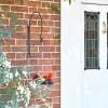 """Shepherds Crook"" Hanging Basket Wall Bracket in Situ by the Front Door"