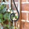 Close-up o fthe Curved Scroll Design Holding a Hanging Basket