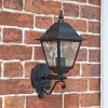 """Sheringham"" Traditional Black Bottom Fix Wall Lantern on a Brick Wall"