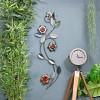 Silver Metallic Flower Wall Art in Situ on a Blue Wall