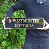 Large Black and Brass House Name sign in hands
