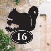 Squirrel Iron House Number Sign on a Garden Wall