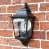 Tattershall Thorpe Black Half Wall Lantern in Situ on a Brick Wall