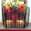 Three fold fire screen on granite hearth