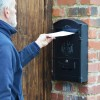 Black Dawsons Lodge Post box mounted on wall