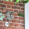 Stainless Steel Wall Lantern in Situ on Brick Wall