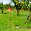 Rustic Orange Mushroom Garden Ornament in Situ in the Garden