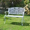 Cast aluminium white garden bench in situ