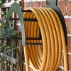 Side View of the Wall Mounted Liver Bird Iron Hose Holder Mounted to a Brick Wall