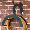 Wall Mounted Boxing Hares Iron Hose Holder Mounted to a Brick Wall