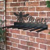 Wall Mounted Bumble Bee Iron Boot Holder Mounted on a Brick Wall