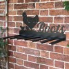 Wall Mounted Hen & Chicks Iron Boot Holder Mounted on a Brick Wall