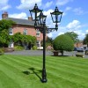 Black Victorian Triple headed lamp post outside house
