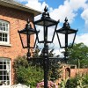 Black Victorian lanterns on ornate brackets