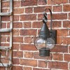 Vintage Round Caged Wall Lantern in Situ on a Brick Wall