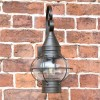 Front View of the Vintage Round Caged Wall Lantern