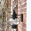 Side View of the Vintage Round Caged Wall Lantern Mounted on a Brick Wall