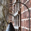 Close-up of the Curved Bracket on the Vintage Round Caged Wall Lantern