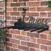 Wall Mounted Robin Iron Boot Holder Mounted on a Brick Wall