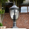 """""""Winsford"""" Black Traditional Countryside Pillar Light in Use in the Garden"""