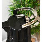 Handle on the Top of the Watering Can
