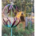 Flower design wind spinner in woodland garden