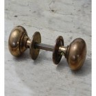 Traditional Door Knobs in Antique Brass
